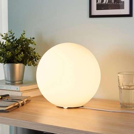 Lindby Guľová sklenená stolná lampa Marike biela